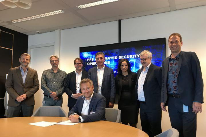 Signing Letter of Intent Consortium Automated Security Operations